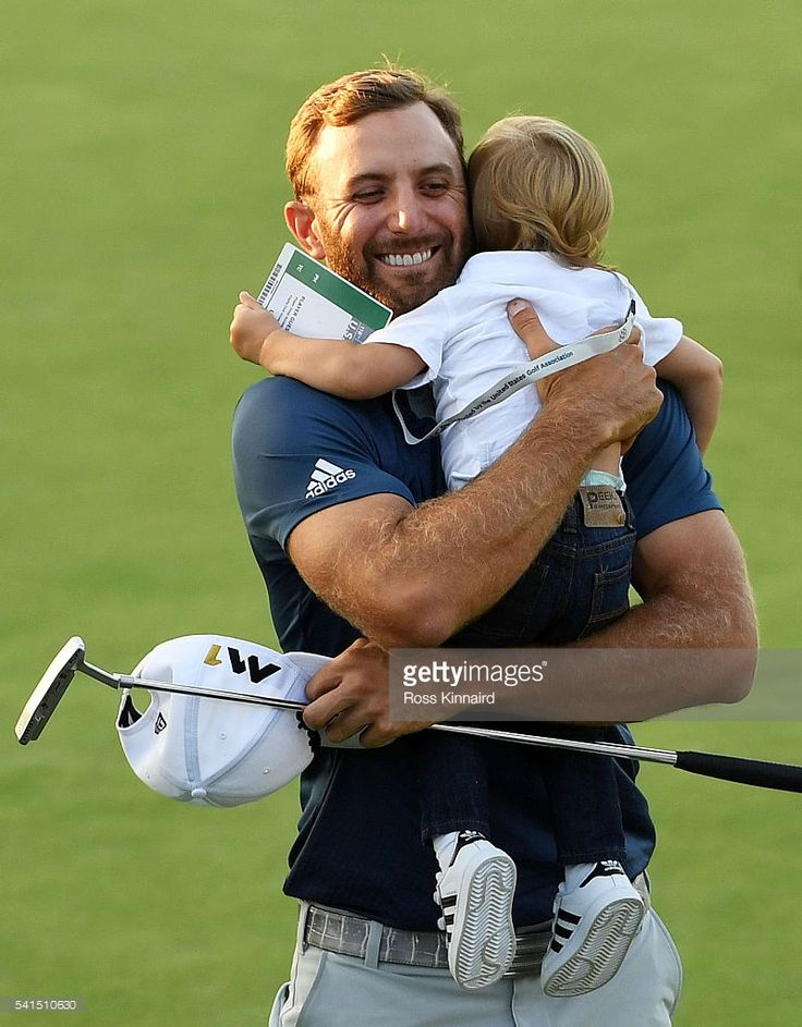 Dustin Johnson. Built more like a running back than a golf player. The little guy must be the Great One's grand kid. Aww.