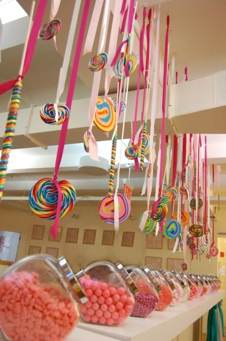 Lollipops hanging from the ceiling add a great touch to the candy bar!