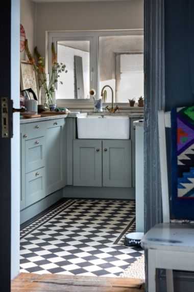 The worktops are granite from M. Roe & Sons in Cabinteely, while the embedded sink is from a kitchen supply store in Dun Laoghaire. The cupboard doors are painted with Farrow & Ball Pigeon.