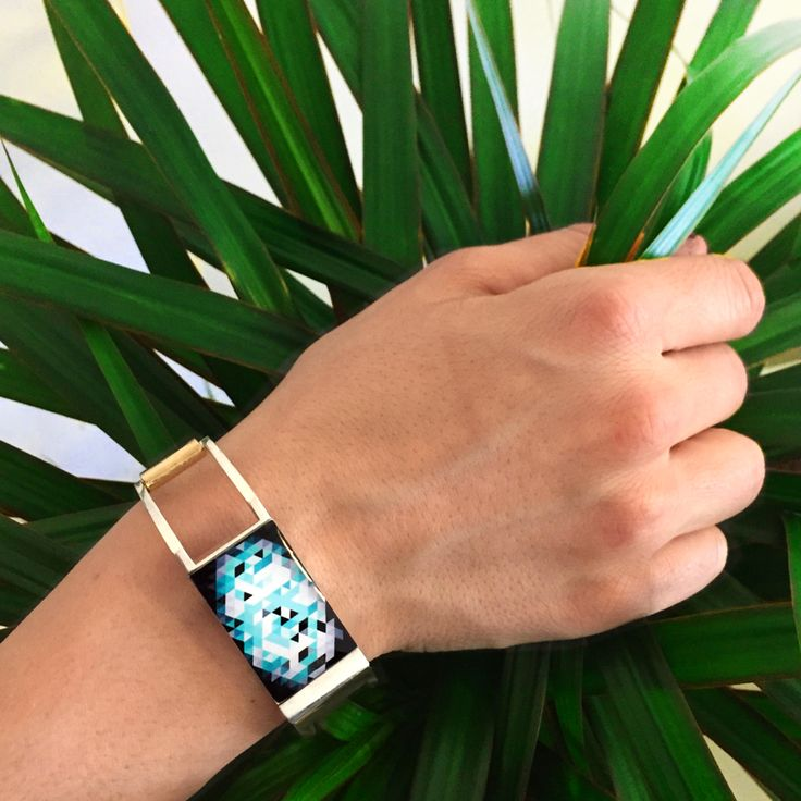 If you like triangular #graphics then Tangram is the perfect Design Tool for you! Discover how to personalize your bracelet watching this #youtube video | http://onti.cc/1CLPb9f | #SpringIsComing.