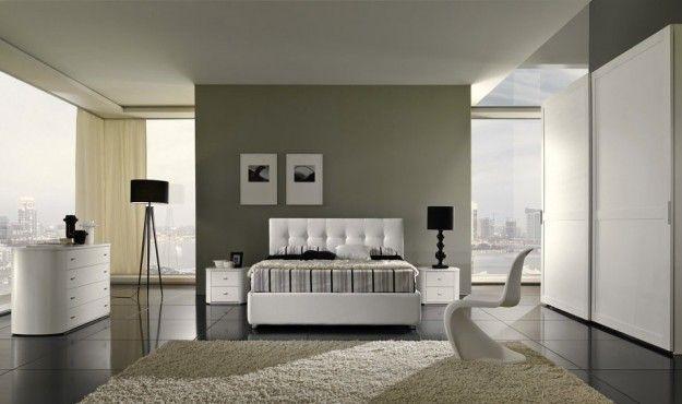 Pareti con diverse tonalità di grigio per camera