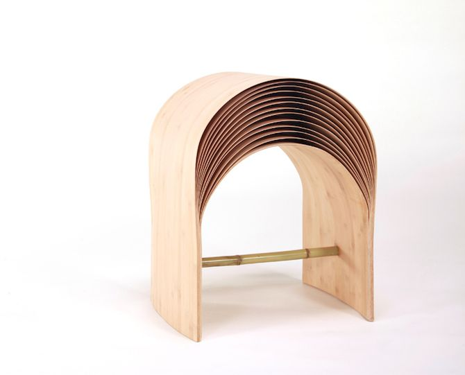 An Arc-Shaped Stool Designed By Min Chen, made of bamboo wood.