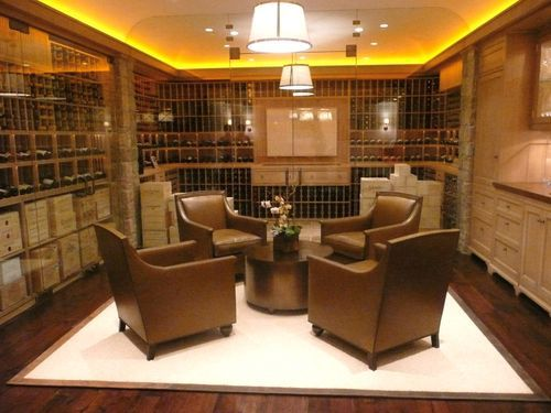 Gorgeous Hard Wood Wine Room with Wooden Wine Box shelving and matching barca loungers