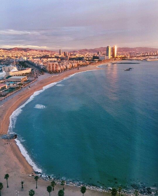 Barcelona Beach - Bargain with a vendor on the street and buy a dope tapestry.