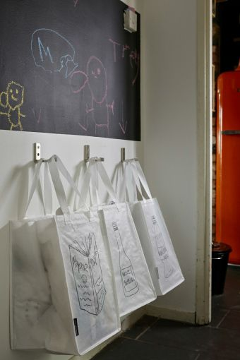 Hang wall hooks to hang recycling bags to free floor space