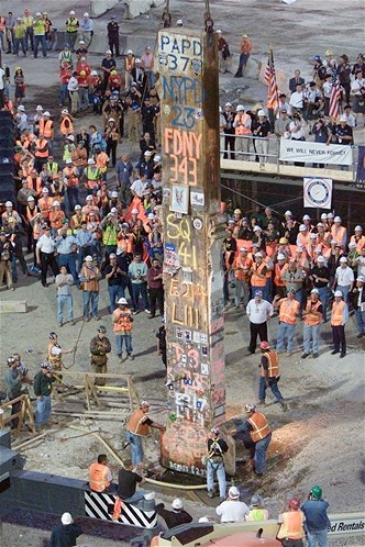 The final standing support beam from the World Trade Center is seen being lifted by crane before being removed from Ground Zero on May 28, 2002. The beam was placed on a flatbed truck and covered in a black cloth. Cleanup at the site ended on May 30, 2002.