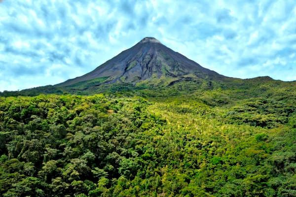 This Costa Rica all inclusive honeymoon package combines heavenly volcano hot springs, stunning white sand beaches, waterfalls, and a sunset catamaran.