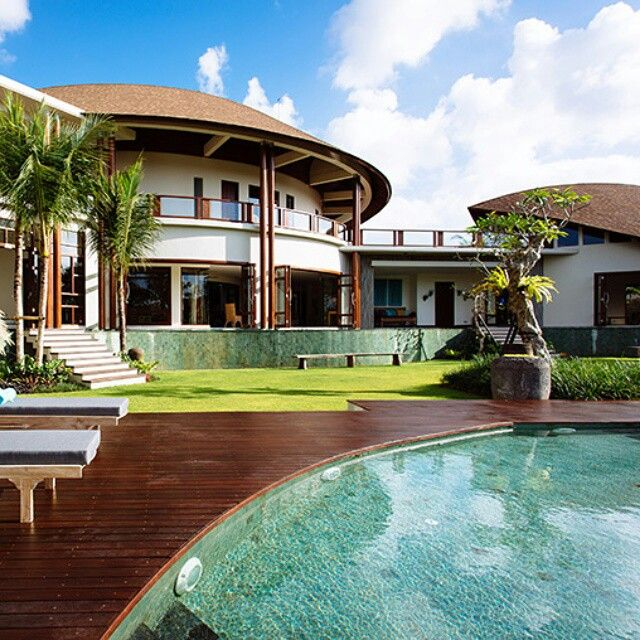 Overlooking an expanse of #riceterraces just north of #Umalas village, and a few kilometres from #Bali's famed #sunset and surf #beaches, Umah Daun – #Indonesian for 'leaf house' – stands out from the crowd with its distinctive, #elegantly bowed roofs. Within a series of pavilions curved around a large #swimmingpool, kids wading pool and #entertainment bale are five large bedroom suites, formal living and dining rooms, a gourmet kitchen, media room, #billiard room, library, kids' playroom…