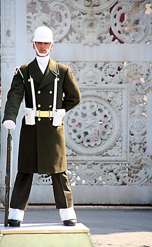 Turkish millitary guard standing in front of Dolmabahçe Palace.