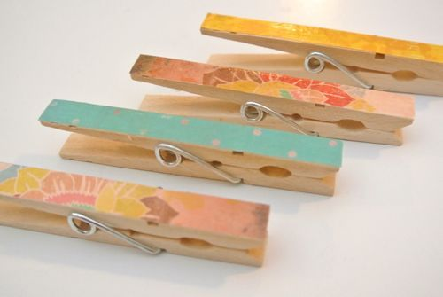 I dressed up clothespins like this with various prints of scrapbook paper.  I wrote one child's name on each clip and attached to the wall with velcro.  This is where they may display their artwork and papers.  Each child has one clip.  When they want something new hung up, they must take the previous dsiplay down.  Saves from having 100 pictures by one child displayed and none from anyone else.