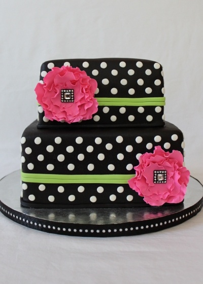 Cake is covered in fondant with fondant decoration and gumpaste fantasy flowers. The bling centers are not edible.