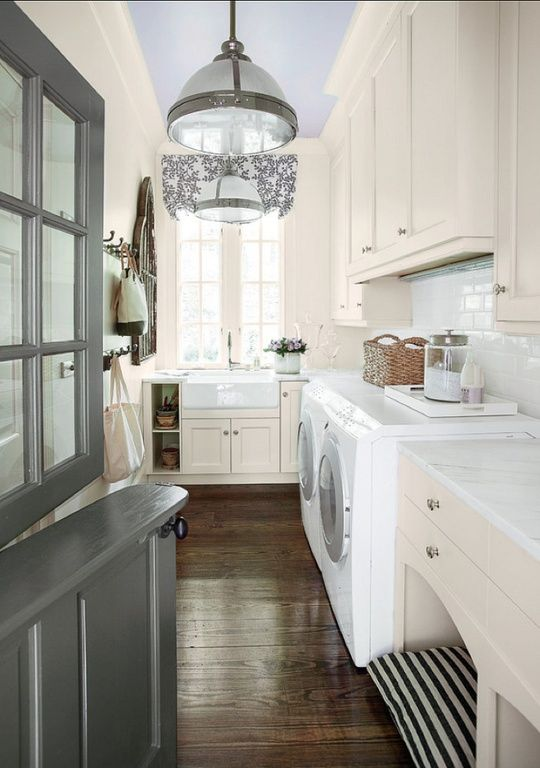 Traditional laundry room with farmhouse sink and Dutch door. #laundryrooms #laundryroomdesigns homechanneltv.com
