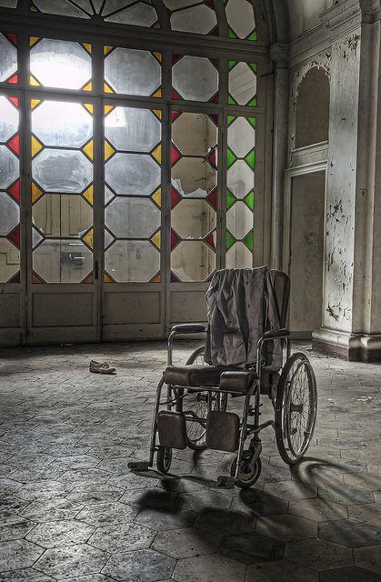 Wheel chair in abandoned asylum italy, via Flickr.