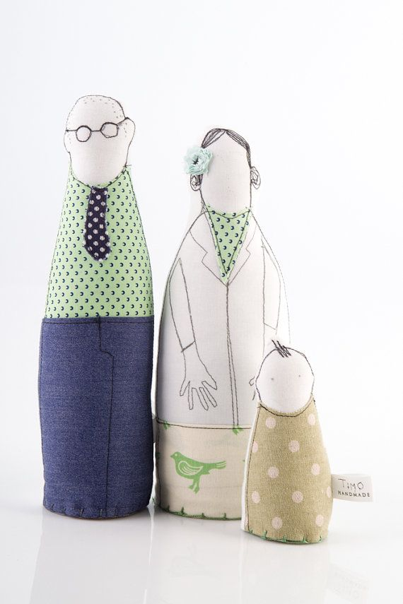 This mother father and toddler dressed in shades of sage green and mint and navy blue is part of TIMO-HANDMADE a small design line.  Sewn with an