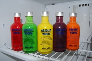 Skittle Absolut Vodka:Bag of Skittles, 5 Vodka Bottles. Separate Skittles by COLOR. Drop Skittles into Bottles separated by COLORS. Pour Vodka in bottle over Skittles until FULL. Add Cap & SHAKE 30 Seconds. Let Sit 1 Day. Use clean WHITE Tshirt to STRAIN Skittles out of VODKA mix & into another Container. Add Food COLOR to BRIGHTEN.