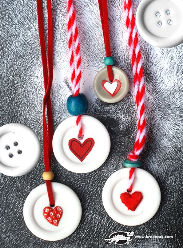 Button pendant necklaces. Would make a cute Mother's Day craft. Easily adaptable to different designs and colors.