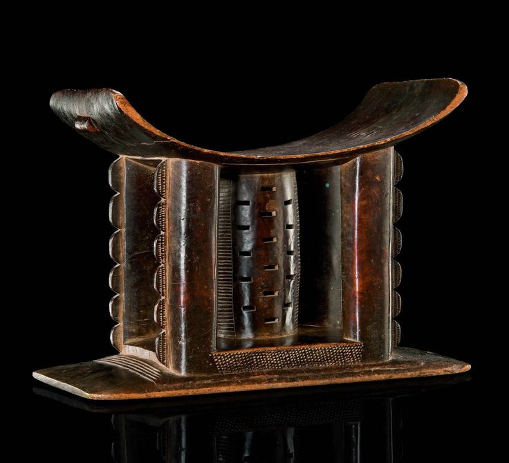 Africa | Stool from the Ashanti people of Ghana | Wood | The symbolic message carved into the pedestal of the stool represents the owner's prestige and authority in the community. There are stools for every status: common ones for the ordinary man or woman, the more elaborate for the king (decorated in gold) or Queen's mother (decorated in silver).