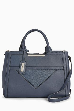 c6461b97b85e Leather and navy spell workwear chic! Our tote bag with its 3 compartments  is spacious to hold your essentials and stylish to make a statement.