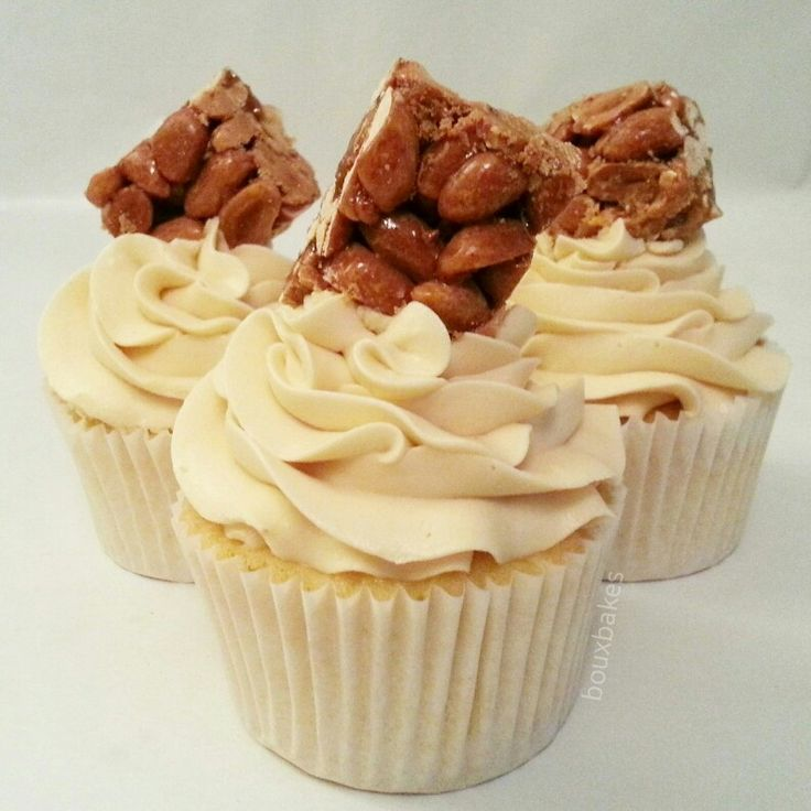 Peanut butter cupcakes topped with crunchy peanut brittle