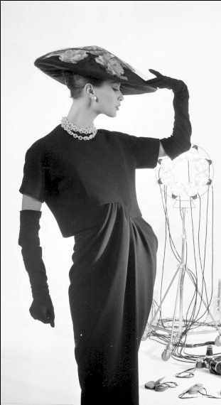 1956 Model in studio setting poses in artfully draped dress by Christian Dior, photo by Willy Rizzo