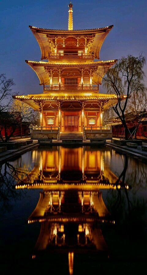 Tower reflection in Shanghai, China. - title Night View - photographer Jiulong Chu