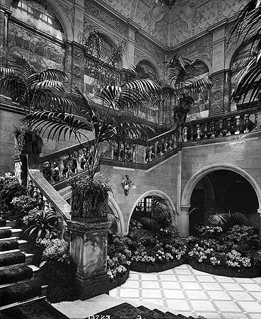 BL13723 Interior of Sheffield Town Hall. Staircase decorated with palms and floral displays supplied by the nurseries of Fisher, Son and Sibray, possibly in preparation for the opening of the town hall by Queen Victoria on May 21st 1897. Photo by Bedford Lemere.