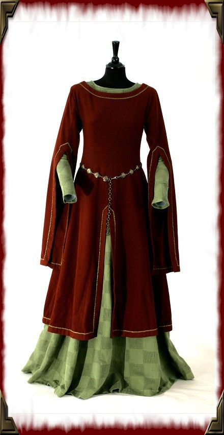 This dress was made by Elisabeth Amnegard-Fisher of Nine Ladies Design  I'm curious about her sources/inspiration.  (Bespoke 14th century medieval  re-enactment gown.)