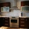 Kitchen Cabinets, Excellent Style Of Kitchen With Wooden Brown Color Of Wall Shelving And White Wall And White Granite Countertop And Wooden Brown Cabinet And Brown Ceramic Floor: Beautiful Design Of All Wood Kitchen Cabinets Wholesale Looked Great And Excellent