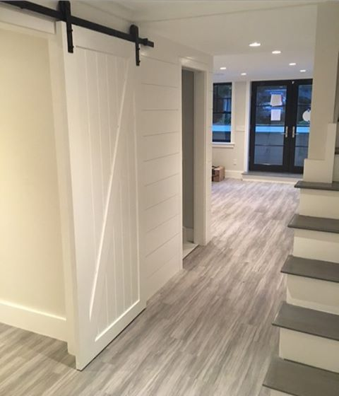 Kinda dying over the progress in this South End basement renovation were doing #shiplap #barndoor #vinylplankforthewin