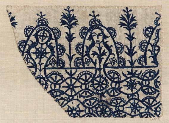 Skirt border  Greek Islands ((Crete)  DIMENSIONS  32 x 37 cm (12 5/8 x 14 9/16 in.); Legacy dimension: .37 x .32  MEDIUM OR TECHNIQUE  Linen and silk; embroidery   ACC NO  14.867 Cut from the border of a skirt. White linen, worked with dark blue silk and a braided stitch often called Oriental stitch. The design consists of undulating lines wheel-like forms and parts of circles. The border on one side has deep scallops, separated by plant-like forms; in one scallop is a face.