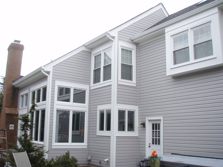 Liberty Elite Victorian Grey Siding, White Aluminum Cladding, Gutters & Downspouts