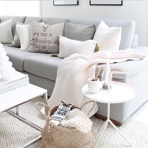 Cream Rug And Blankets For Living Room On Grey Sofa