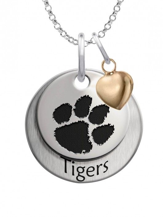 Clemson Tigers with Heart Accent  Our beautiful layered charm set featuring your school logo on the top charm, school mascot name on the bottom charm, and accented with the perfect little gold plated heart. We use the finest sterling silver and combine with high tech laser technologies to create this personalized collegiate necklace collection. Bottom charm is brush finished for contrast.  Solid Sterling Silver  Officially Licensed  Made In The U.S.A.  Large Charm Measures 17mm