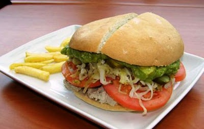 lomito completo (roast pork sandwich with sauerkraut, tomatoes, avocado and mayonnaise)