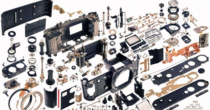 Photos of disassembled cameras are usually created by laying out the parts…
