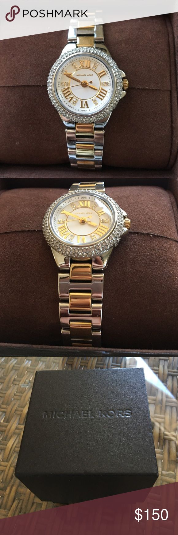 New Michael Kors Watch New with tags silver and gold Michael Kors watch. This watch has rhinestones incrusted around the face and within the watch face. The wristband has gold in the center of the band and silver on the outside. Michael Kors Accessories Watches