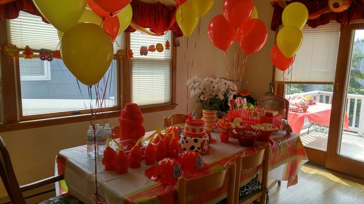 aidan's 4th: party table. personalized helmets for each kid, lollies, marshmallow treats, firefighter caviar, hydrant Pinata