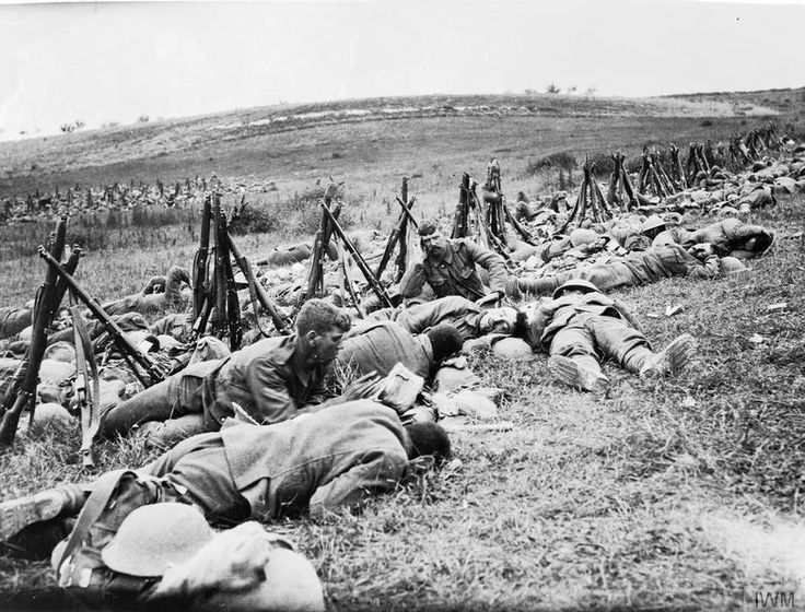 THE BATTLE OF THE SOMME, JULY-NOVEMBER 1916 Men of the Royal Warwickshire Regiment, their rifles stacked nearby, lying exhausted in the grass in a rear area.