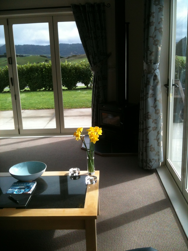 The winter sun streaming in through the lounge windows at Bella Vista Vineyard Cottage - with such a lovely view just to sit and admire.