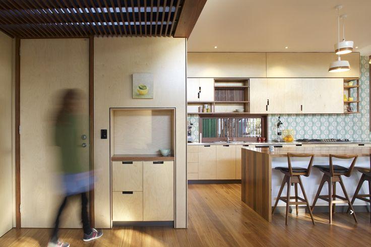 www.arcke.com.au. Bardon Garden House. Entry, kitchen and dining. #arcke #brisbanearchitect #contemporaryarchitecture #plywood