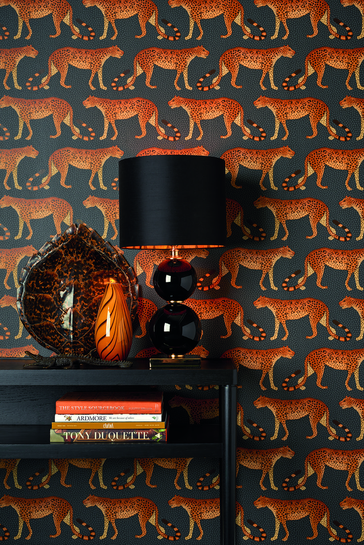 Leopards march left and right across this wallpaper | Leopard Walk by Cole & Son | Jane Clayton