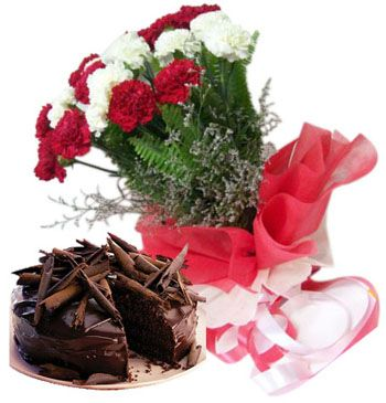 Flowers Delivery in Delhi and cakes by Florist in Delhi 	This enthralling bunch will assure your place in the heart of those you love. Blooming blossoms in combination with the exotic cake ensure that it is simply sensational. ? 10 white n red carnations wrapped up in tissue & decorated with ribbons ? 500 gm rich and sumptuous truffle cake