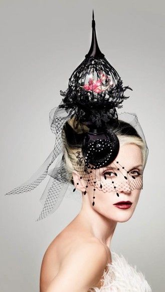 Daphne Guinness wearing a Philip Treacy hat with an 18th century ruby swallow brooch courtesy of Wartski. Vogue Italia, 2010.