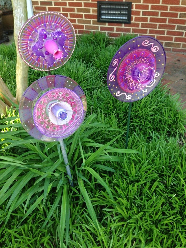 17 best images about recycled glass yard art on pinterest for Recycled glass flowers