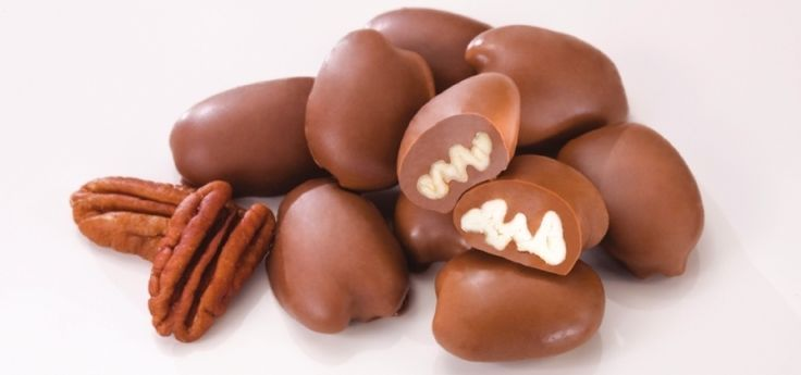 25 gifts under $50! Send a southern staple to loved ones near and far during the holidays. A tin of chocolate covered pecans costs $10.95.  Image courtesy of Mascot Pecan Shelling Company.