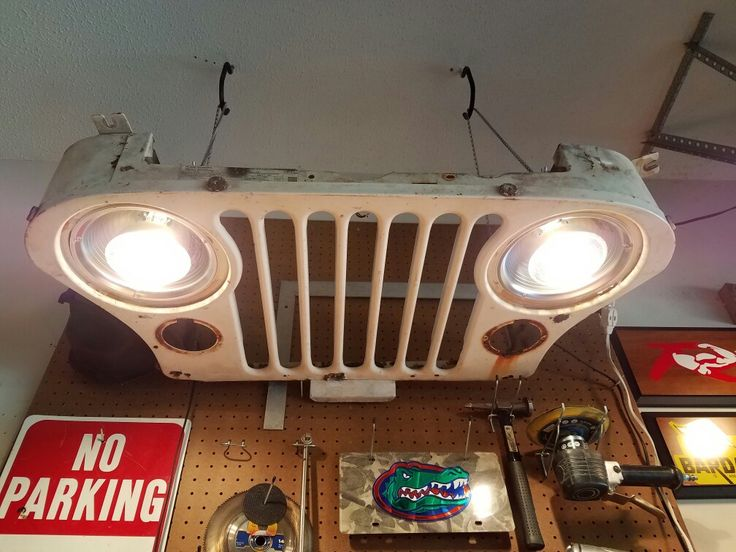 """Workbench Light: Jeep CJ grille my son bought for $2. Two 8"""" clamp lights bought at Lowes & 2 chains from an old garage door."""