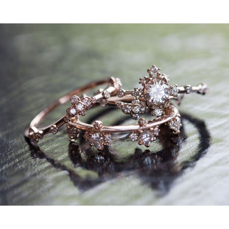 Curved Willow Band , Plum Blossom Band, and the Camellia Ring by Kataoka