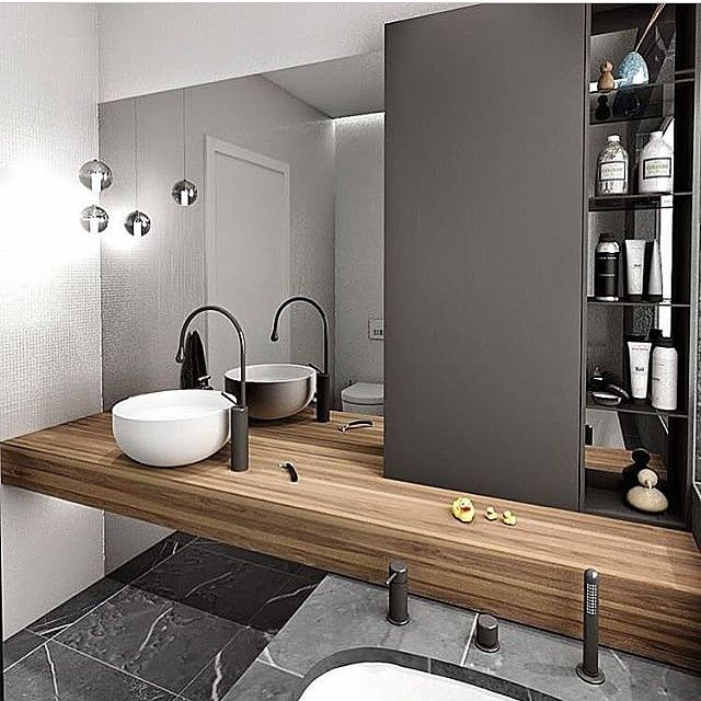Hardwood timber floating vanity, white round basin, matte black tap and mixer, matte black spout, white mosaic tiled wall, black calacatta tiled floor. #taps #interiordesign #bathroom #australia #architecture #bathroomdesign #bathroomcollective Visit our website for more www.bathroomcollective.com.au