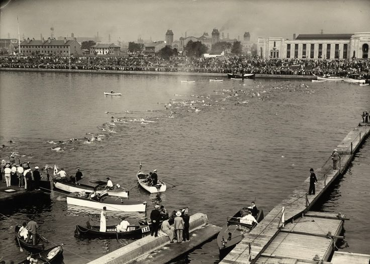 The 1930 marathon swim at the Ex. You can see sailors policemen on the docks, the New Fort across the water at right and the factories blackening the sky as hundreds look on.
