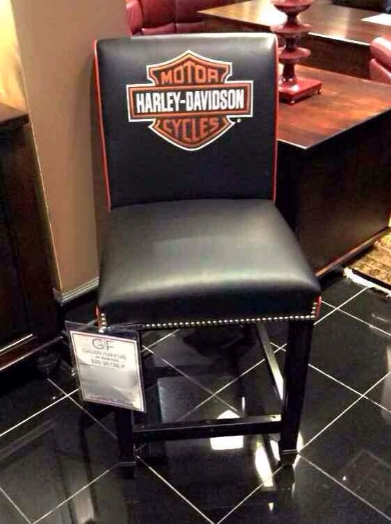 This Harley Davidson accent chair is the perfect accent piece for any motorcycle lover! Smooth black leather and orange accents work beautifully with the nailhead trim detail to create your new favorite furniture piece! | Houston TX | Gallery Furniture |